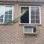 green curtain red brick